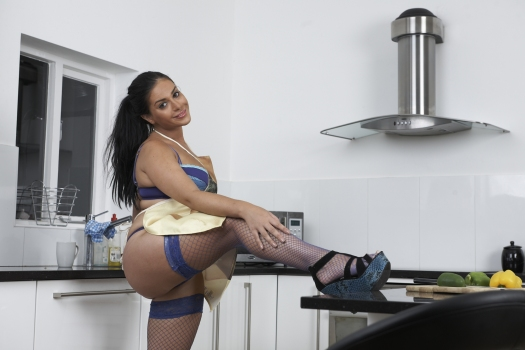 Keira jones  novelty aprons and naughty nylons. Keira is busy in the kitchen but her novelty apron looks a little misplaced. Why wear a libidinous body apron when the real one is so much better? 'All the better to tease you' says Keira. Well she won't tease you too much and you'll soon see her foxy fishnets and so much more……