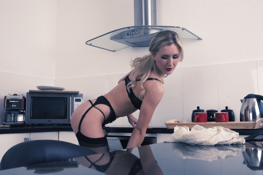 Sam tye  time for tea. What's a girl to do whilst she's waiting for the kettle to boil? Genius that she is; Sam uses this time to provide you with a titillating tease to work up your thirst. Looking ever so smart; her black stockings and suspenders are a better accompaniment for tea than biscuits will ever be. Even better; she still gives you something to nibble on too!